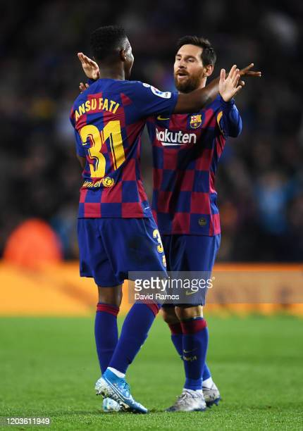 Ansu Fati of FC Barcelona celebrates with Lionel Messi of FC Barcelona his sides first goal during the Liga match between FC Barcelona and Levante UD...