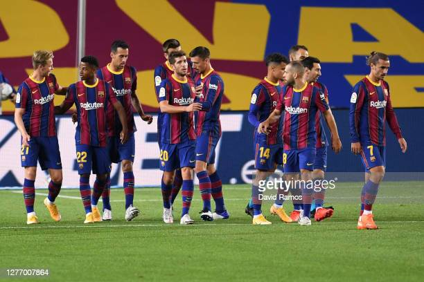 Ansu Fati of FC Barcelona celebrates with teammates after scoring his sides first goal during the La Liga Santander match between FC Barcelona and...