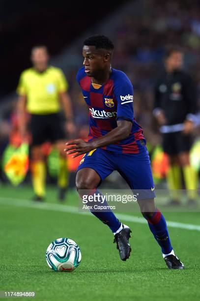 Ansu Fati of FC Barcelona conducts the ball during the La Liga match between FC Barcelona and Valencia CF at Camp Nou on September 14 2019 in...