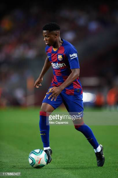 Ansu Fati of FC Barcelona conducts the ball during the Liga match between FC Barcelona and Villarreal CF at Camp Nou on September 24, 2019 in...