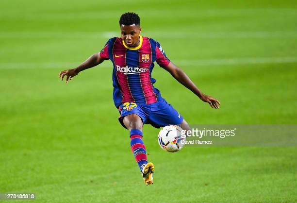 Ansu Fati of FC Barcelona controls the ball during the La Liga Santander match between FC Barcelona and Sevilla FC at Camp Nou on October 04, 2020 in...