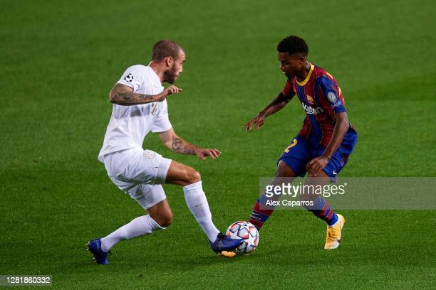 Ansu Fati of FC Barcelona is challenged by Miha Blazic of Ferencvaros Budapest during the UEFA Champions League Group G stage match between FC...