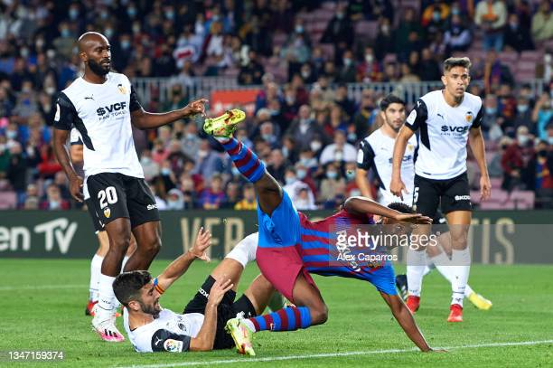 Ansu Fati of FC Barcelona is fouled by Jose Luis Gaya of Valencia CF which leads to a FC Barcelona penalty during the LaLiga Santander match between...