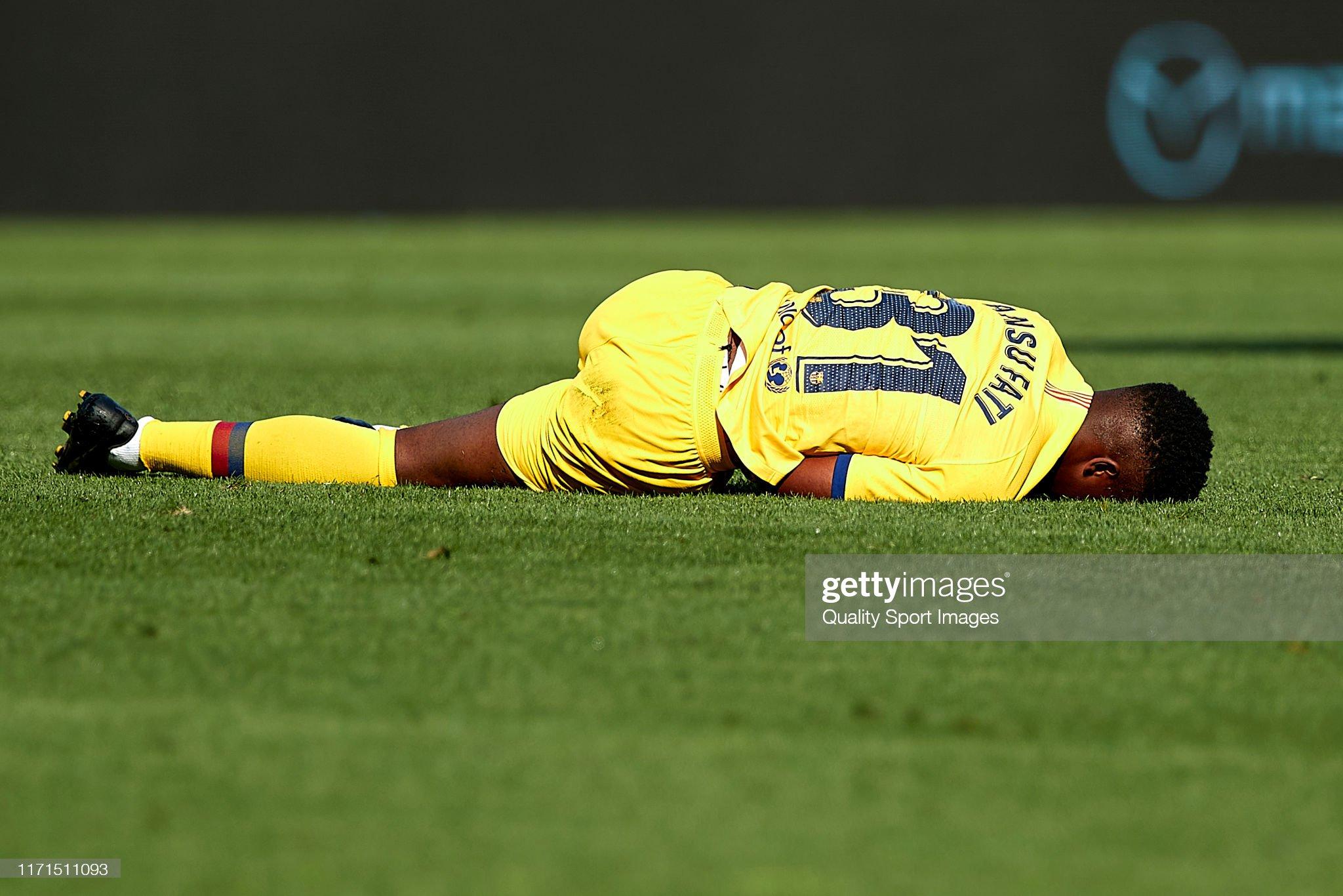 صور مباراة : أوساسونا - برشلونة 2-2 ( 31-08-2019 )  Ansu-fati-of-fc-barcelona-over-the-pitch-injured-during-the-liga-ca-picture-id1171511093?s=2048x2048