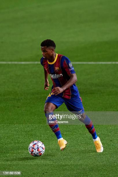 Ansu Fati of FC Barcelona runs with the ball during the UEFA Champions League Group G stage match between FC Barcelona and Ferencvaros Budapest at...