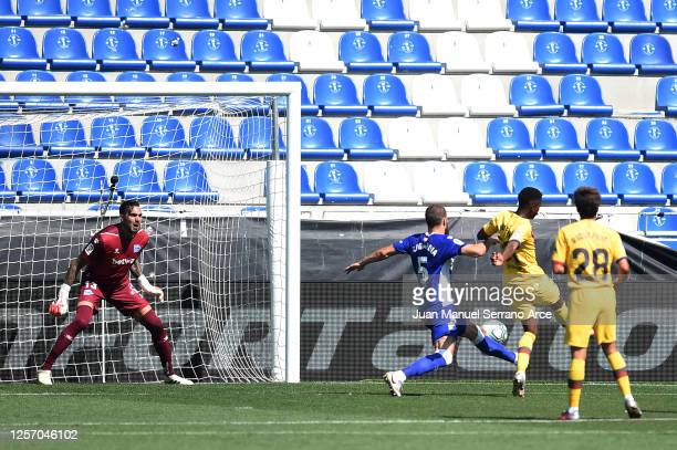 Ansu Fati of FC Barcelona scores his sides first goal during the Liga match between Deportivo Alaves and FC Barcelona at Estadio de Mendizorroza on...