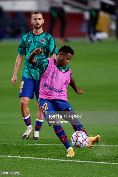 Ansu Fati of FC Barcelona warms up prior to the UEFA Champions League Group G stage match between FC Barcelona and Ferencvaros Budapest at Camp Nou...