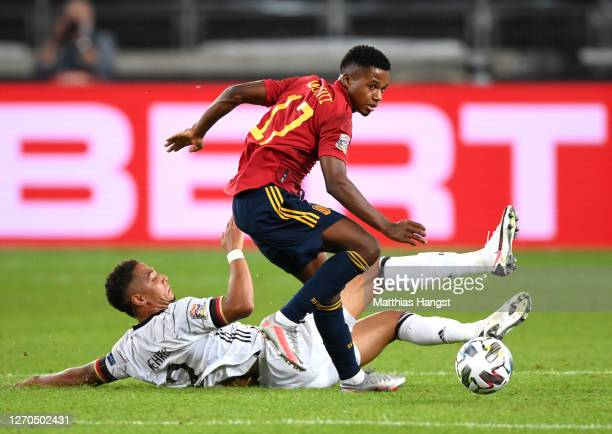 Ansu Fati of Spain battles for possession with Thilo Kehrer of Germany during the UEFA Nations League group stage match between Germany and Spain at...
