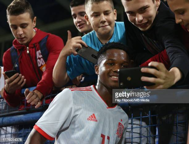 Ansu Fati of Spain poses for selfies with the fans after the 2019 UEFA European Under21 Championship Qualifying match between Montenegro and Spain on...