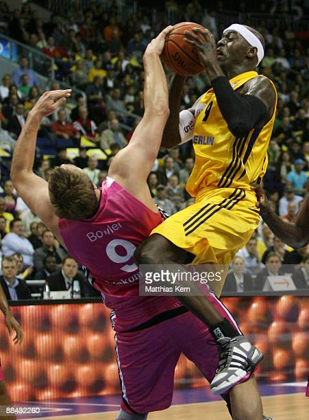 Ansu Seasay of Berlin shoots as John Bowler of Bonn defends during the BBL PlayOffs fifth semifinal match between Alba Berlin and Telekom Baskets...