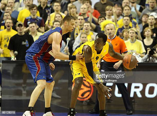 Ansu Sesay #9 of Alba Berlin competes with David Andersen #13 of Regal FC Barcelona during the Euroleague Basketball Last 16 Game 4 match between...