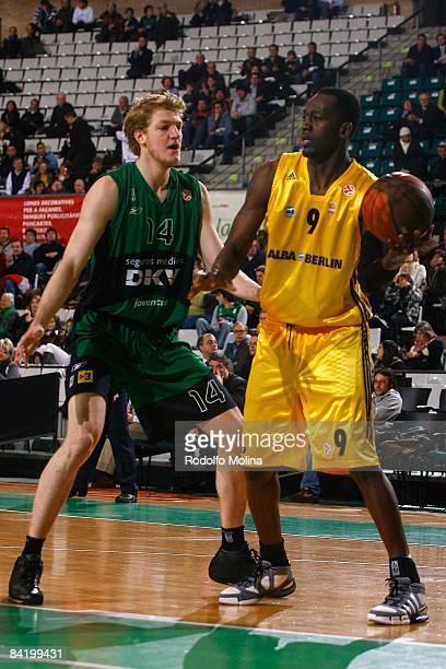 Ansu Sesay #9 of Alba Berlin competes with JanHendrick Jagla #14 of DKV Joventut during the Euroleague Basketball Game 9 match between DKV Joventut...