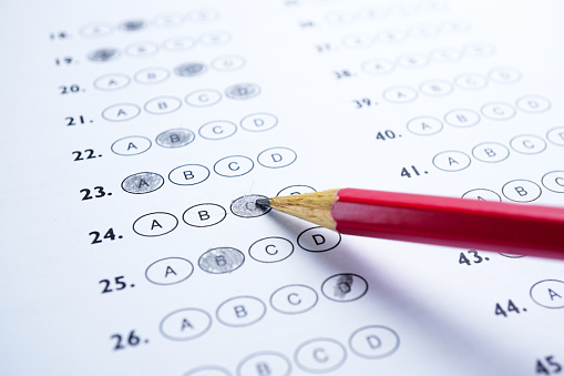 Answer sheets with Pencil drawing fill to select choice : education concept 1054873316