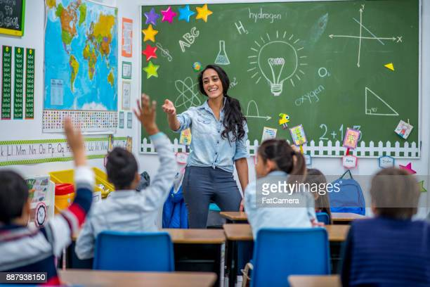 answering a question - blackboard stock photos and pictures