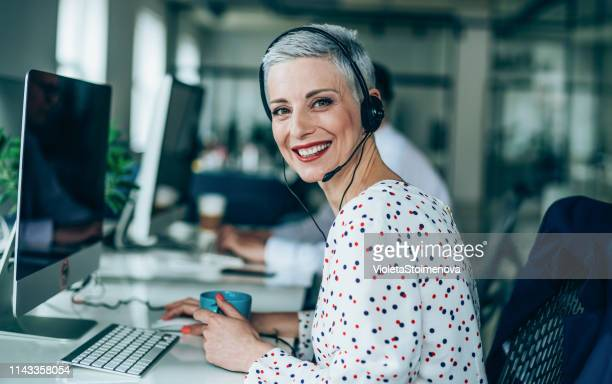 answering your call with a smile - call center stock pictures, royalty-free photos & images
