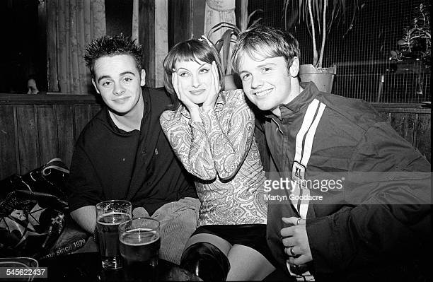 Ant and Dec Anthony McPartlin and Declan Donnelly with a fan at the Good Mixer pub Camden London United Kingdom 1994