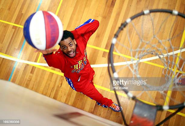 Ant Antkinson of the Harlem Globetrotters takes a shot at the basket during a Harlem Globetrotters media session at Youthtown on May 23 2013 in...