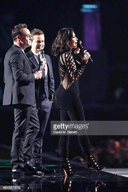 Ant Dec welcome Kim Kardashian West to the stage at the BRIT Awards 2015 at The O2 Arena on February 25 2015 in London England