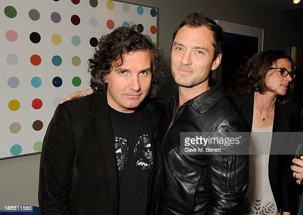 Ant Genn and Jude Law attend the annual fundraising art auction in aid of Teenage Cancer Trust at The Groucho Club on May 15 2013 in London England