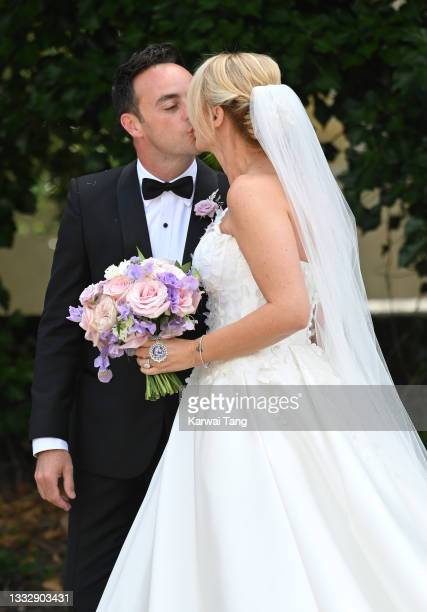 Ant McPartlin and Anne-Marie Corbett pose for the photographers after their wedding at St Michaels Church in Heckfield on August 07, 2021 in Hook,...