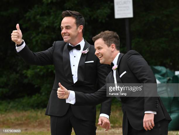 Ant McPartlin and best man Declan Donnelly seen arriving at his wedding to Anne-Marie Corbett at St Michael's Church in Heckfield on August 07, 2021...