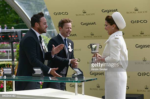 Ant McPartlin and Declan Donnelly present the winning prize to owner Princess Haya Bint Al Hussei for winning the Jersey Stakes on day 2 of Royal...