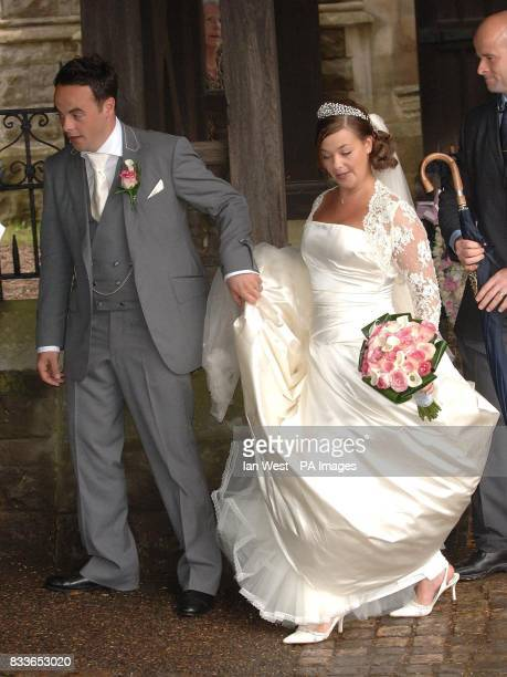 Ant McPartlin and Lisa Armstrong after their wedding at StNicholas Church in Taplow Buckinghamshire Picture date Saturday July 22 2006