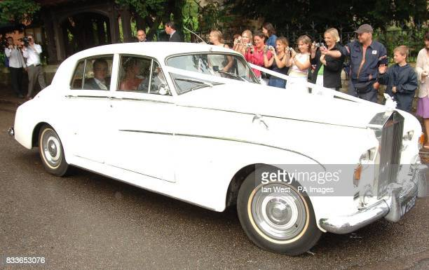 Ant McPartlin and Lisa Armstrong leave after their wedding at StNicholas Church in Taplow Buckinghamshire Picture date Saturday July 22 2006