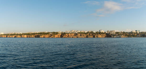 Antalya City (Antalya Falezler) view from the water to the clifftop coast apartments, Antalya, Turkey