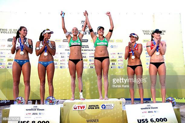 Antalya Open beach volley tournament winners pose in the stage October 24 in the Mediterranian resorty city of Antalya Turkey