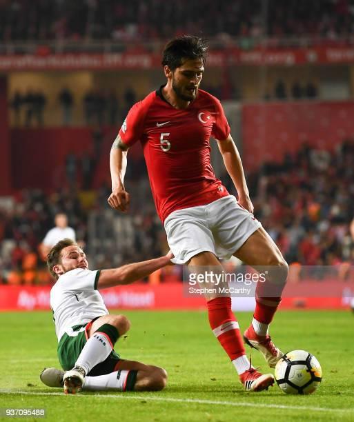 Antalya Turkey 23 March 2018 Okay Yokulu of Turkey in action against Alan Judge of Republic of Ireland during the International Friendly match...