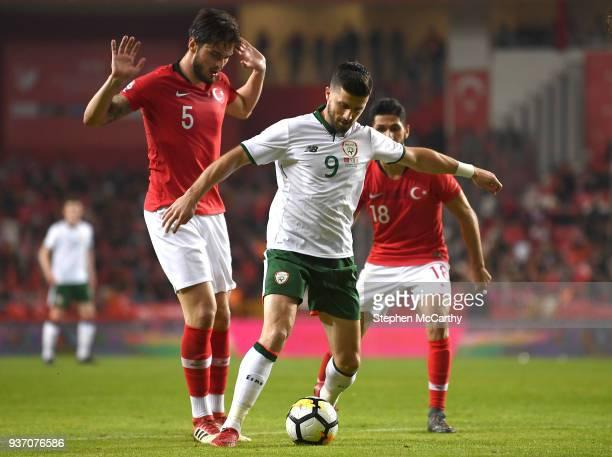 Antalya Turkey 23 March 2018 Shane Long of Republic of Ireland in action against Okay Yokulu left and Emre Akbaba of Turkey during the International...