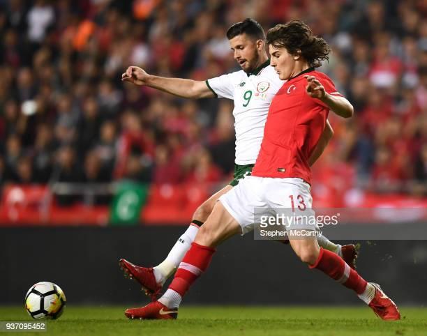Antalya Turkey 23 March 2018 Shane Long of Republic of Ireland in action against Çalar Söyüncü of Turkey during the International Friendly match...