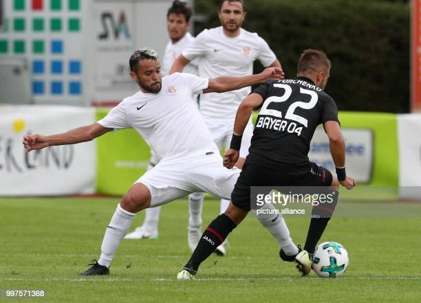 Antalya's Chalet da Silva and Leverkusen's Vladlen Yurchenko vie for the ball during the soccer friendly between Bayer Leverkusen and Antalyaspor in...
