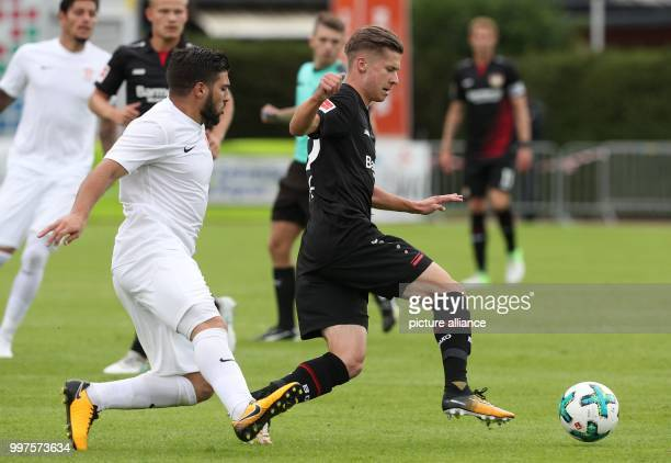 Antalya's Mostafa El Kabir and Leverkusen's Jakob Bednarczyk vie for the ball during the friendly match between Bayer Leverkusen and Antalyaspor in...