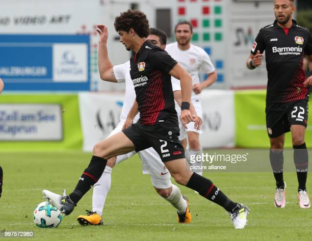 Antalya's Mostapha El Kabir and Leverkusen's Andre Ramalho vie for the ball during the friendly match between Bayer Leverkusen and Antalyaspor in...