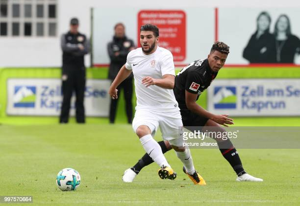Antalya's Mostapha El Kabir and Leverkusen's Benjamin Henrichs vie for the ball in the soccer friendly between Bayer Leverkusen and Antalyaspor in...