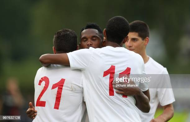 Antalya's Mostapha El Kabir Antalya's Samuel Eto'o and Antalya's Maicon Marques Bitencourt celebrate after the 11 during the test match between Bayer...