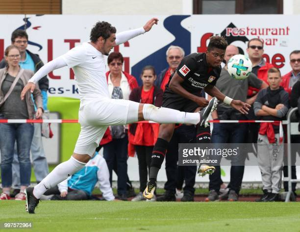 Antalya's Salih Dursun and Leverkusen's Leon Bailey vie for the ball during the friendly match between Bayer Leverkusen and Antalyaspor in Zell am...
