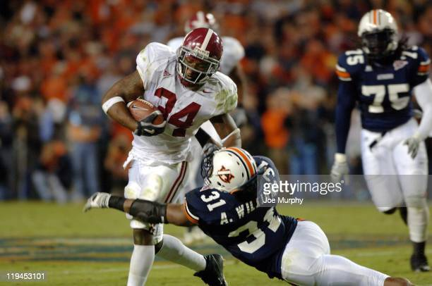 Antamious Williams tackles Kenneth Darby during second half action The Auburn Tigers beat the Alabama Crimson Tide 2818 on November 19 2005 at...