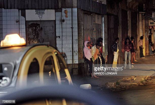 A group of young Malagasy prostitutes pictured 29 November 2006 in a street of the Tsaralalan district of Antananarivo in Madagascar At sunset their...