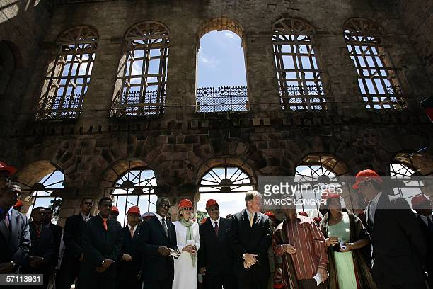UN Secretary General Kofi Annan and his wife Nane together with Madagascar President Marc Ravalomanana and his wife Lalao pause 17 March 2006 during...