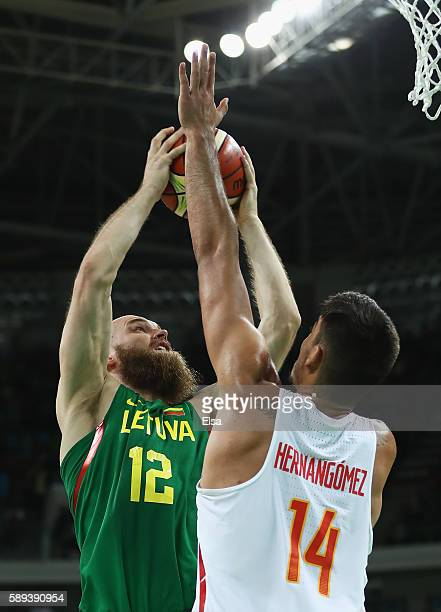 Antanas Kavaliauskas of Lithuania shoots over Guillermo Hernangomez Geuer of Spain during the Men's Preliminary Round Group B between Spain and...