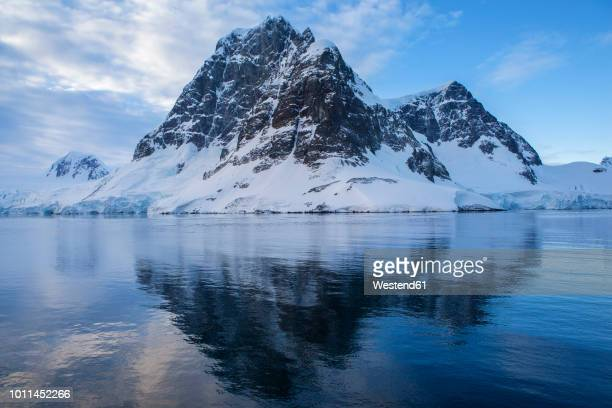 antarctic, antarctic peninsula, glaciated mountains in lemaire channel - antarctic peninsula stock pictures, royalty-free photos & images