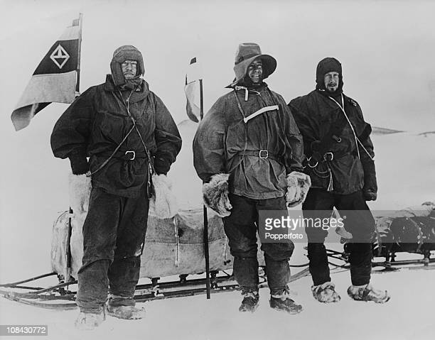 Antarctic explorers Ernest Shackleton Robert Falcon Scott 1868 – 1912 and Edward Wilson at the start of a sledging trip during the Discovery...