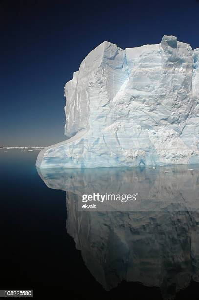 antarctic iceberg in calm water - antarctic sound stock pictures, royalty-free photos & images