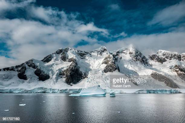 Antarctic mountains and an Iceberg