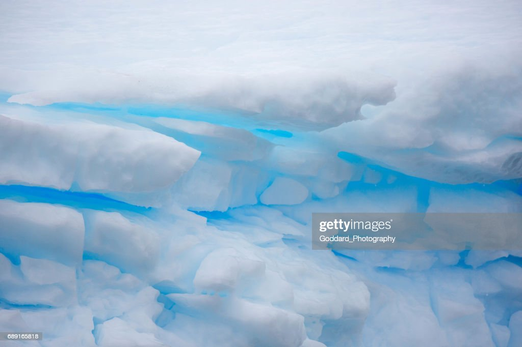 Antarctica: Blue Snow in the Lemaire Channel : Stock Photo