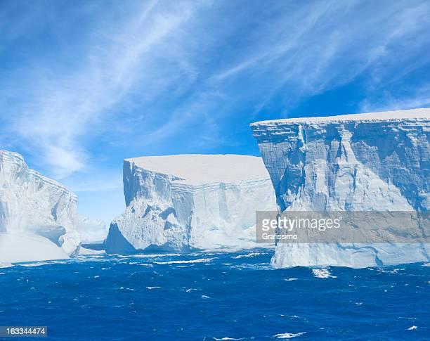 antarctica giant blue iceberg floating - antarctica stockfoto's en -beelden