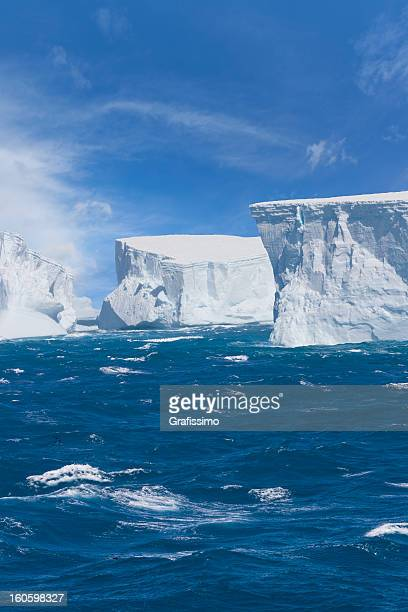antarctica giant iceberg floating - antarctic peninsula stock pictures, royalty-free photos & images